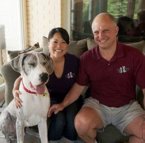 Owners Katy and John at home with their dog Ryder
